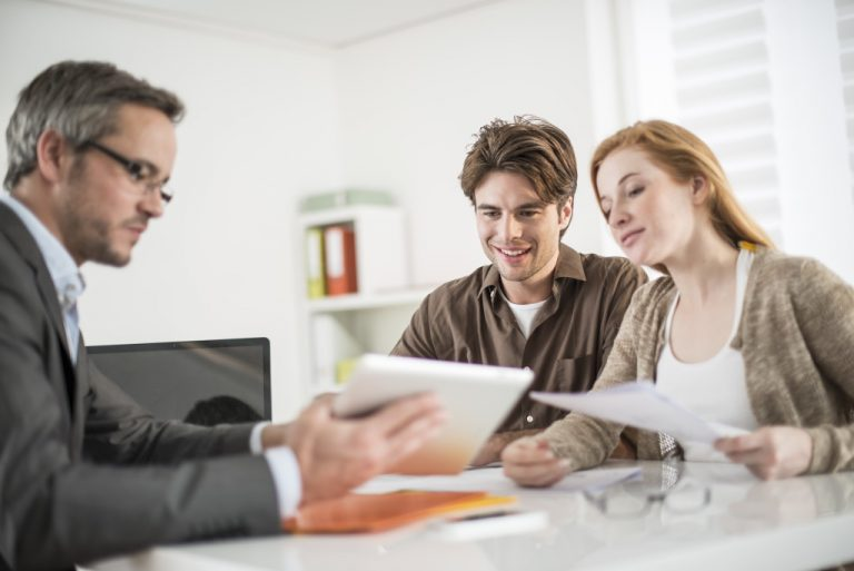 real estate agent handling papers